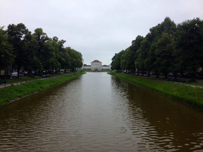 The view of Schloss Nymphenburg from the end of the canal within the palace's English Garden.